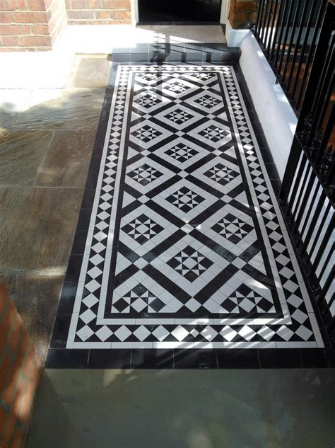 Black and white victorian mosaic tile path red brick