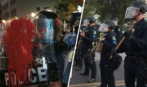 St Louis riots: Guns confiscated as POLICE sprayed with