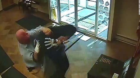 Bank customer takes down a robbery suspect - CNN Video